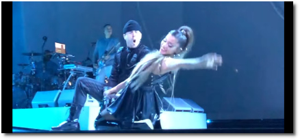 Ariana smiling big while she lays back in the middle of Break Free at the Mohegan Sun in Connecticut (30 March 2019)