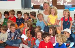 Twenty kindergarten students in class with their teacher