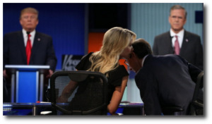 Megyn Kelly whispers into the ear of Chris Wallace during Republican presidential debate in Cleveland on August 6, 2015